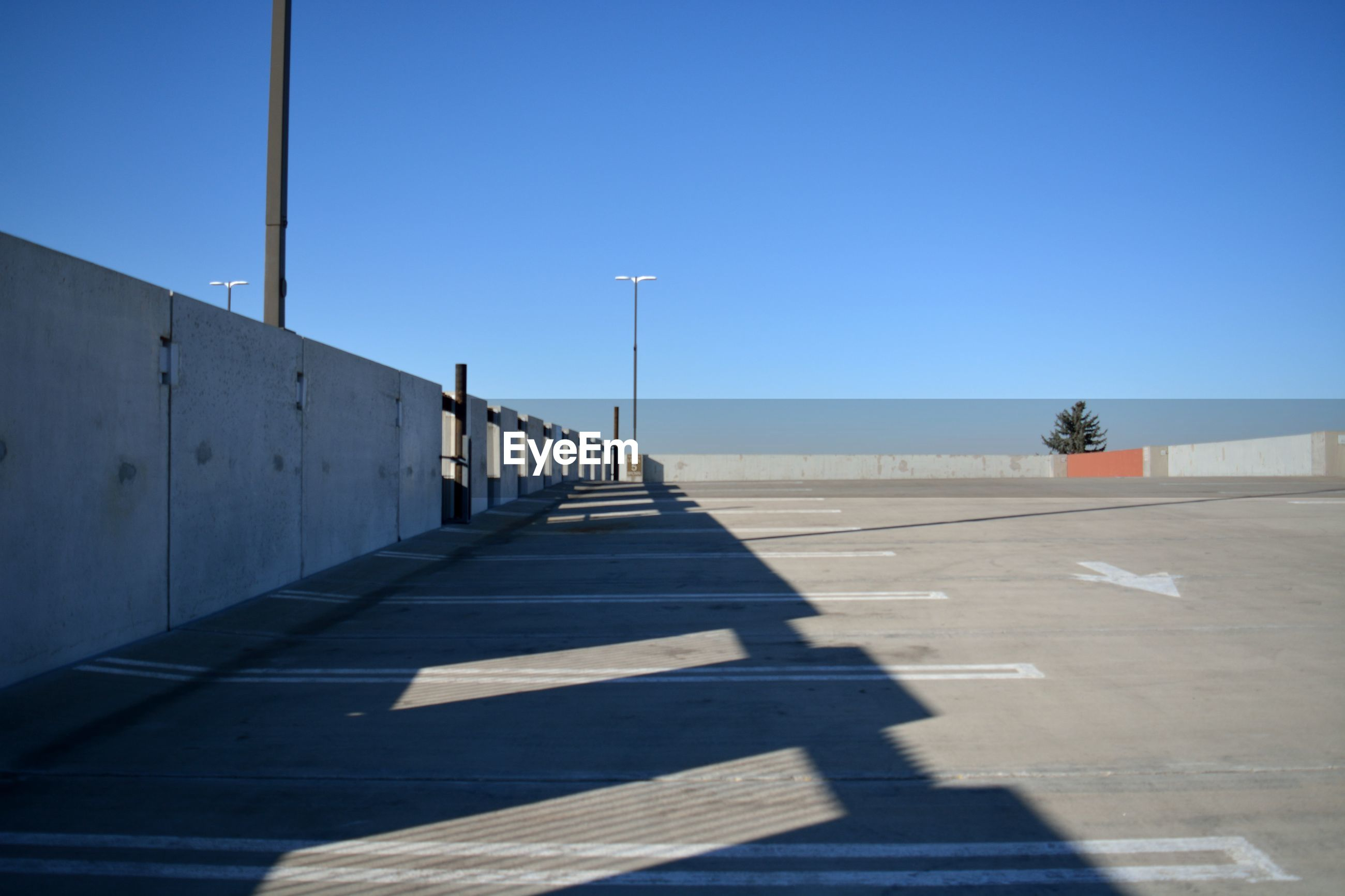 Empty parking lot against clear sky
