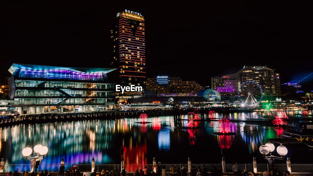 building exterior, night, architecture, illuminated, built structure, water, city, reflection, building, office building exterior, tall - high, skyscraper, sky, waterfront, modern, no people, tower, nature, river, cityscape, outdoors, financial district