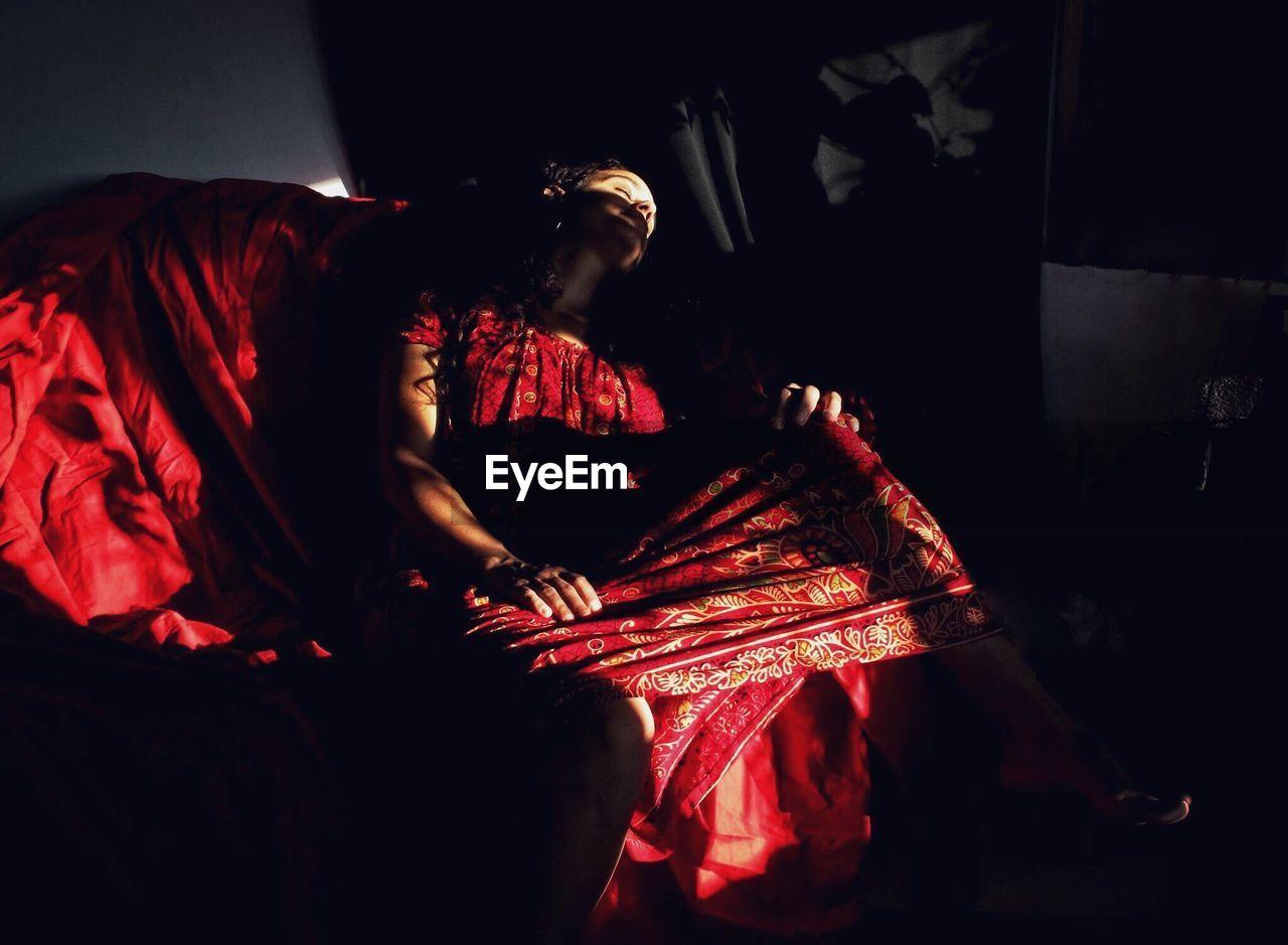 Woman Relaxing In Shade