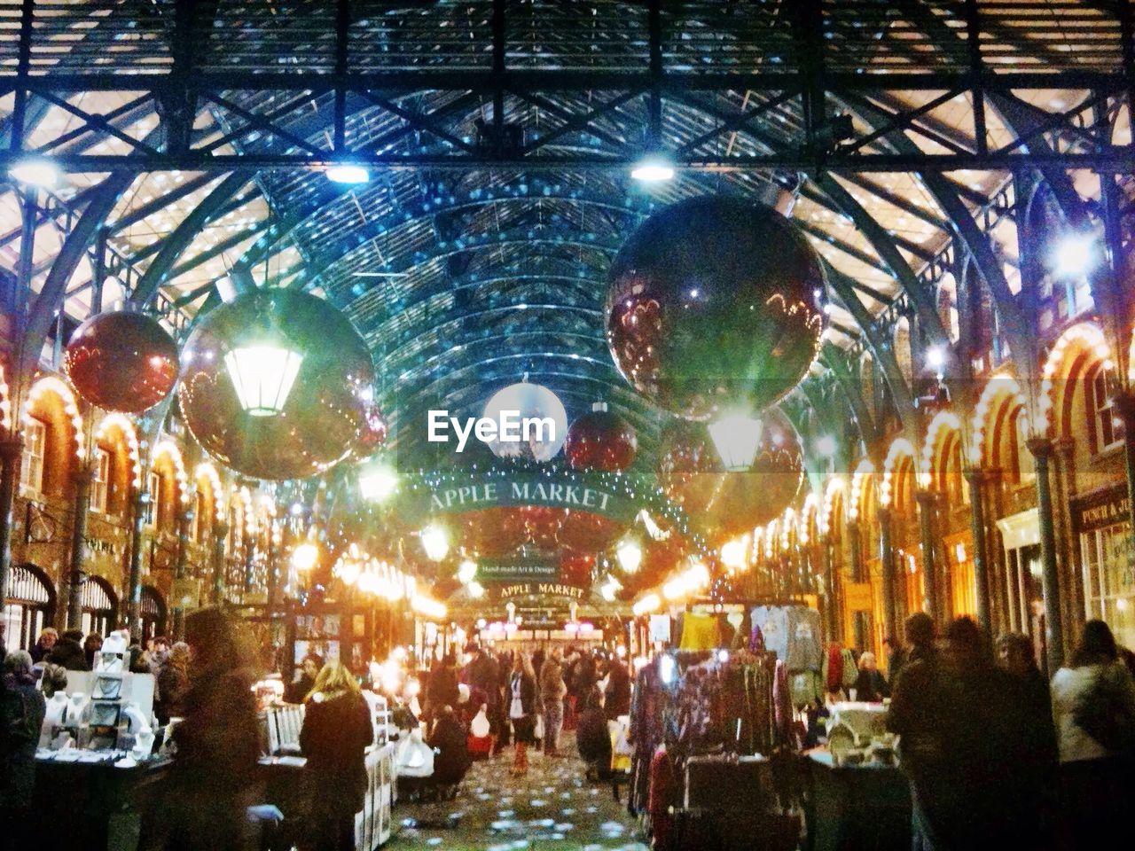 People At Illuminated Market
