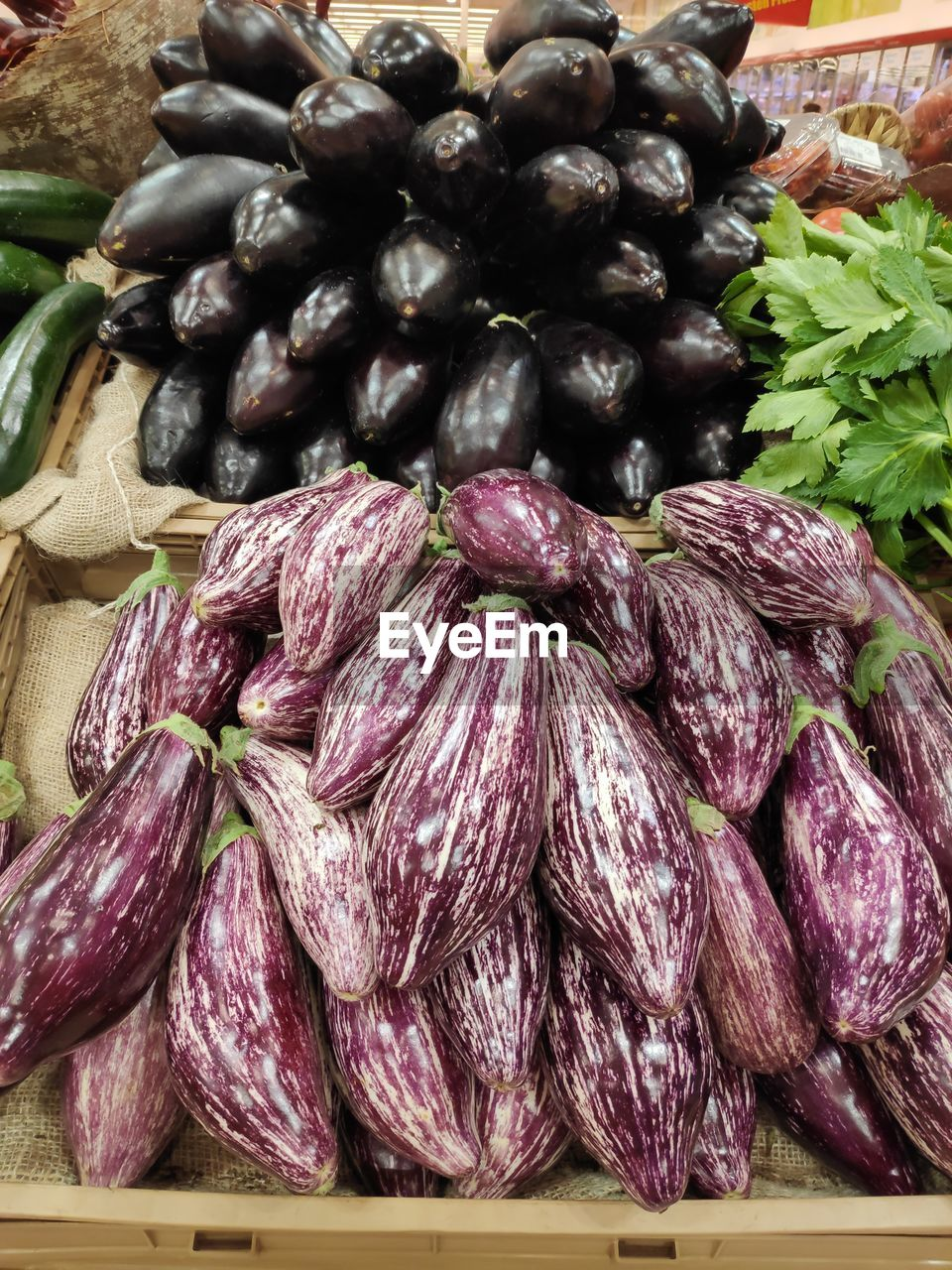 food and drink, food, freshness, healthy eating, vegetable, market, still life, wellbeing, large group of objects, raw food, for sale, no people, retail, abundance, eggplant, business, market stall, green color, indoors, heap, purple, retail display, street market