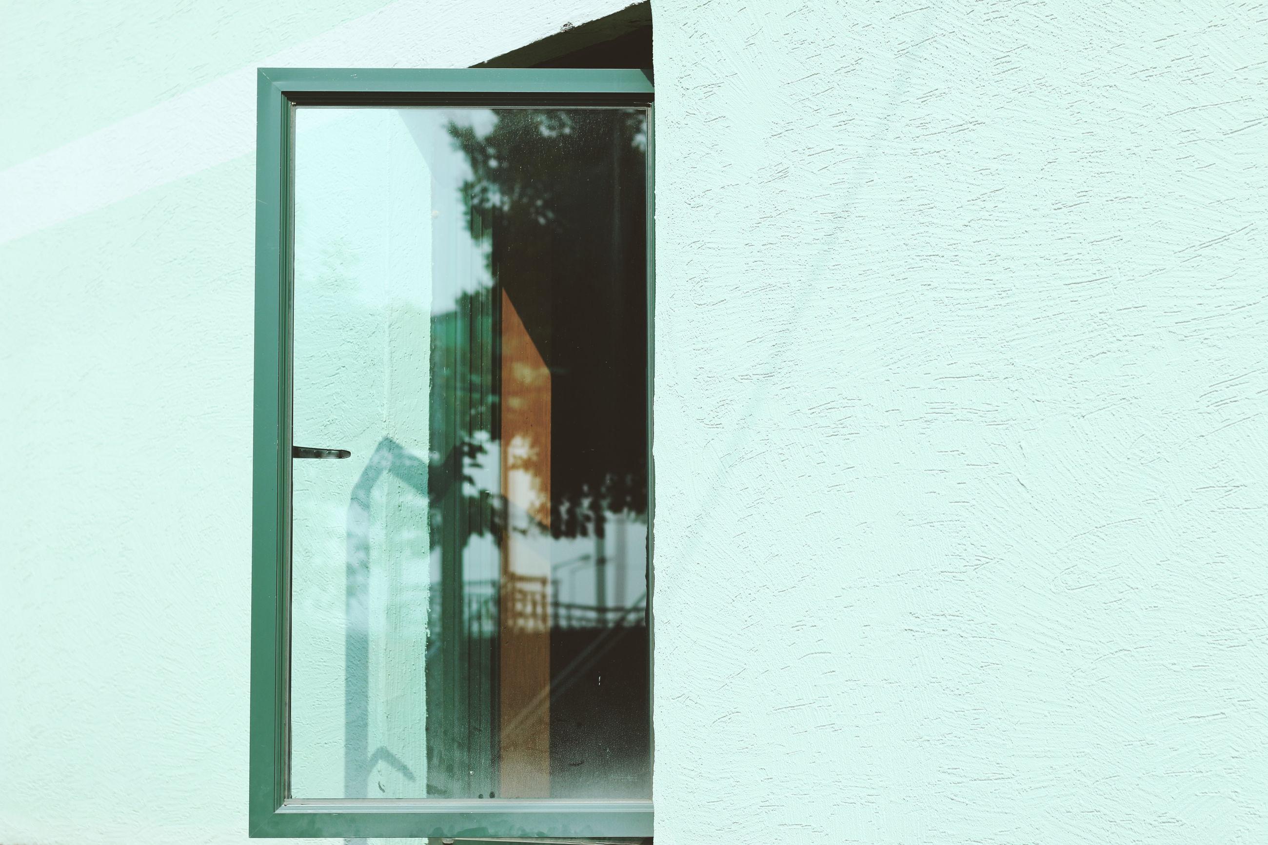 Open window of blue house