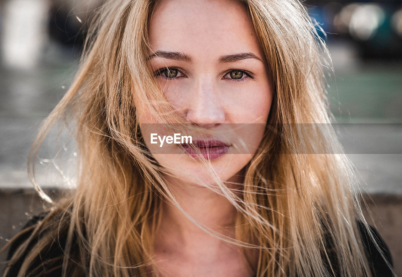 portrait, hair, long hair, headshot, one person, looking at camera, young adult, hairstyle, young women, beauty, front view, focus on foreground, blond hair, beautiful woman, real people, women, lifestyles, leisure activity, outdoors, human face, human hair