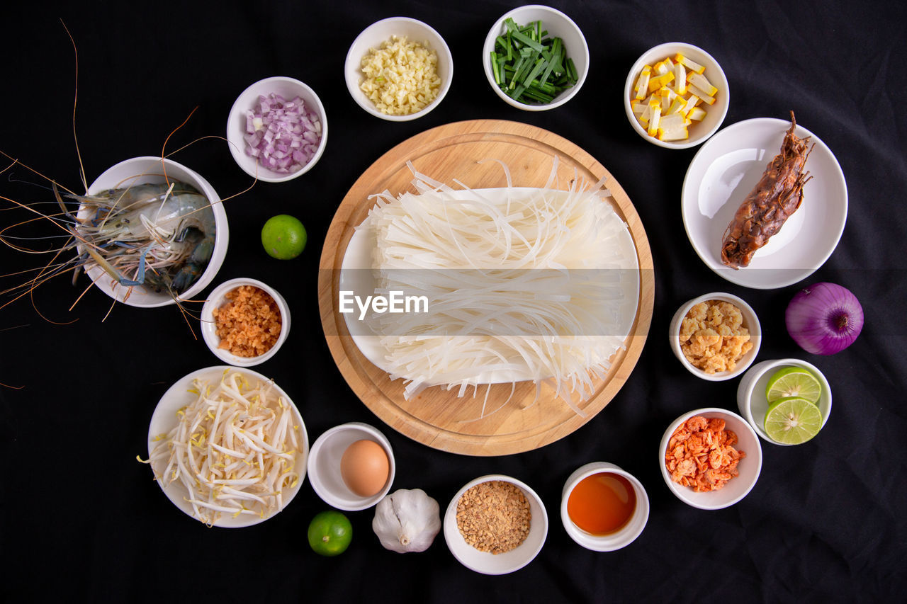 HIGH ANGLE VIEW OF BREAKFAST ON TABLE AGAINST BLACK BACKGROUND