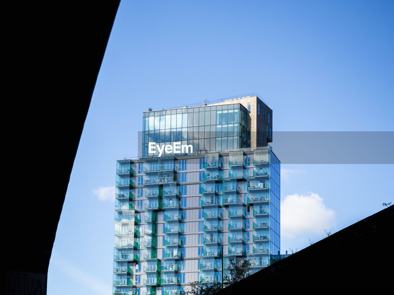 architecture, sky, built structure, building exterior, low angle view, blue, no people, building, nature, office building exterior, day, modern, clear sky, city, glass - material, outdoors, office, tall - high, skyscraper, reflection