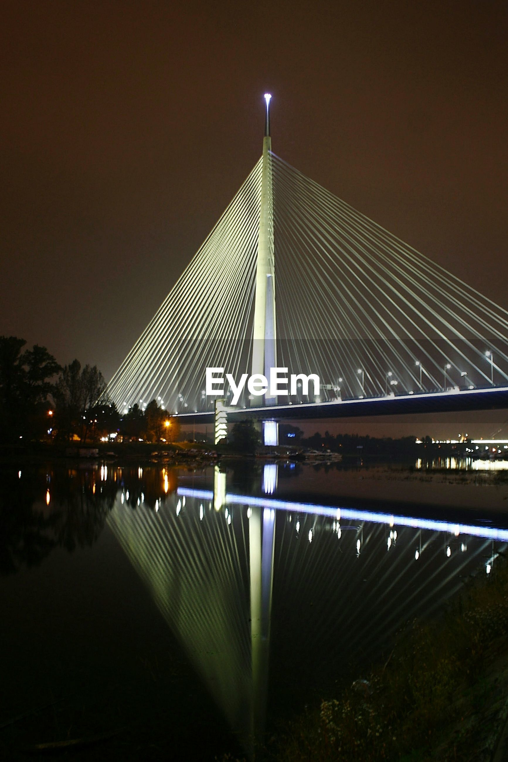connection, bridge - man made structure, built structure, night, architecture, illuminated, engineering, bridge, suspension bridge, river, sky, low angle view, long, clear sky, reflection, water, tree, no people, dusk, outdoors