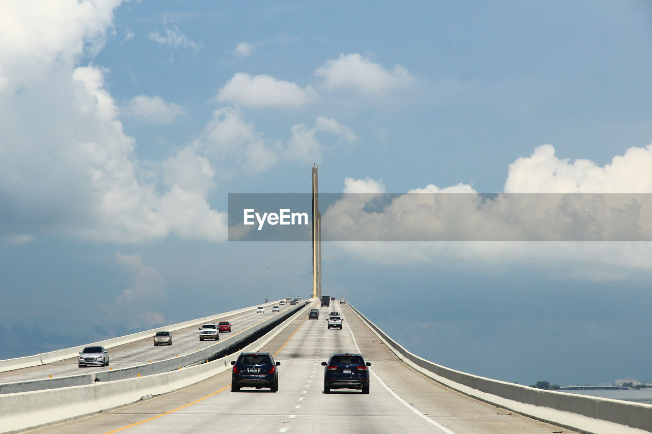 transportation, cloud - sky, sky, mode of transport, car, land vehicle, road, day, no people, outdoors