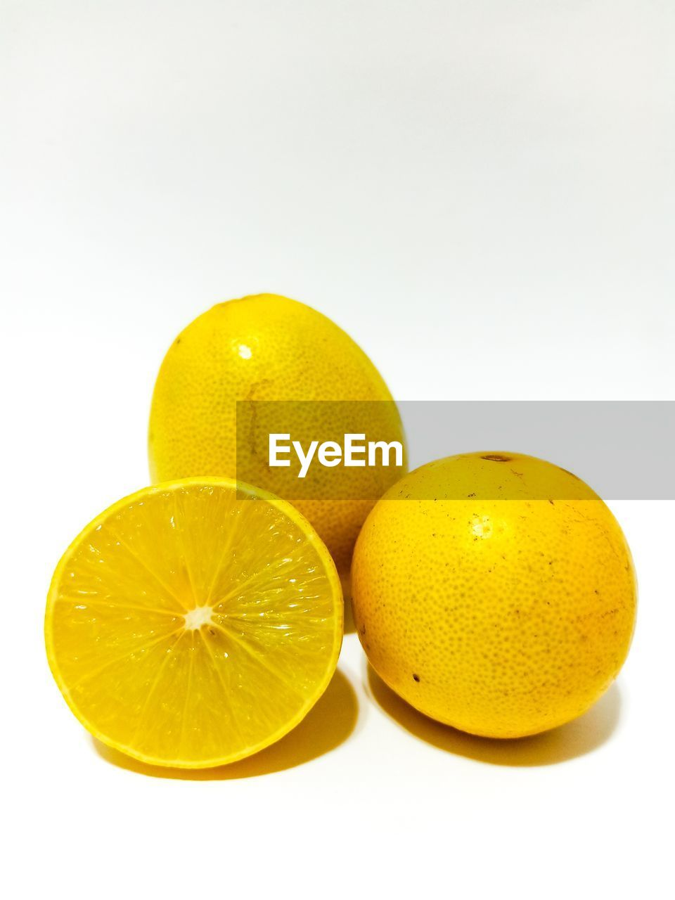 white background, studio shot, fruit, healthy eating, citrus fruit, food, food and drink, freshness, wellbeing, still life, lemon, yellow, indoors, close-up, copy space, group of objects, no people, cut out, cross section, lime, orange
