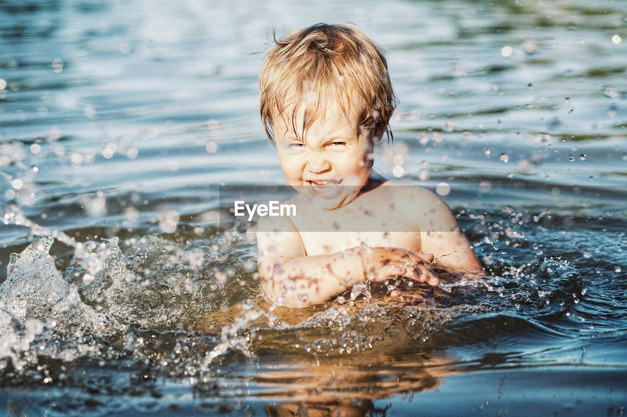 child, childhood, water, boys, one person, real people, portrait, men, offspring, males, day, motion, shirtless, splashing, nature, headshot, hair, innocence, outdoors