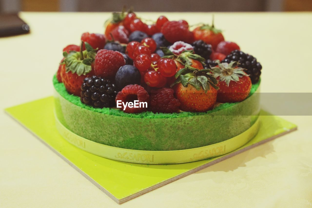food and drink, food, berry fruit, fruit, freshness, healthy eating, table, indulgence, indoors, sweet food, close-up, sweet, dessert, cake, still life, ready-to-eat, focus on foreground, temptation, strawberry, baked, no people, tart - dessert
