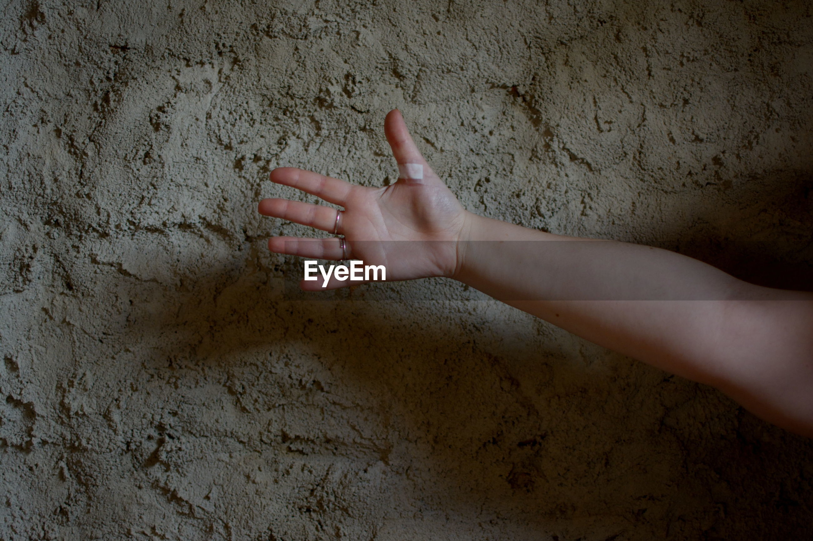 human hand, hand, human body part, one person, real people, wall - building feature, body part, finger, human finger, gesturing, lifestyles, wall, touching, indoors, day, unrecognizable person, leisure activity, showing, child, human limb
