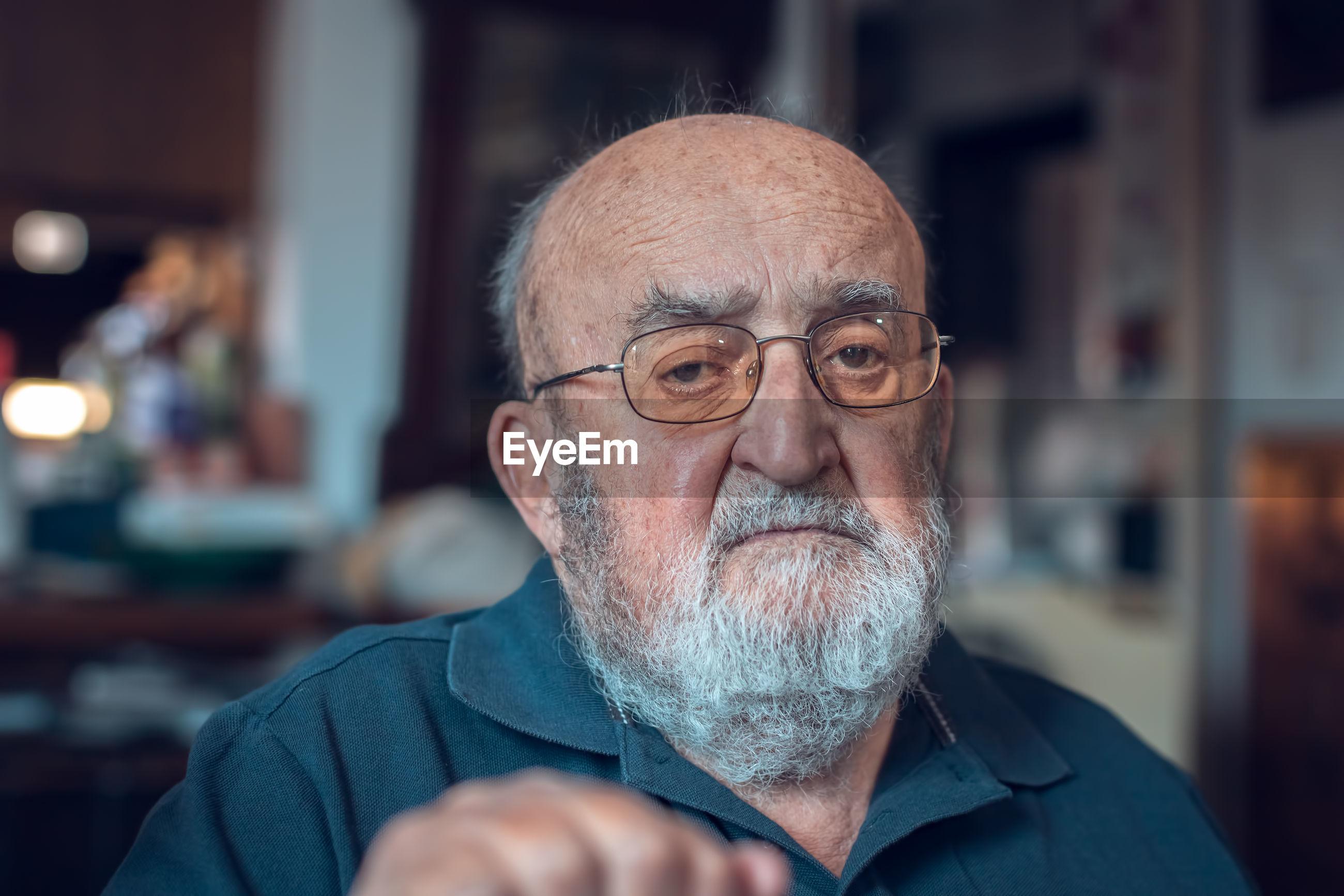 Portrait of old man wearing eyeglasses