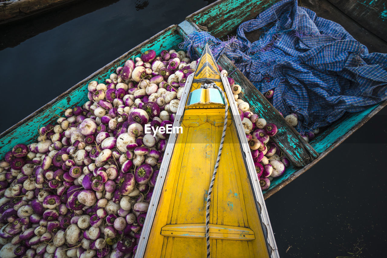 High angle view of vegetables in boat over lake