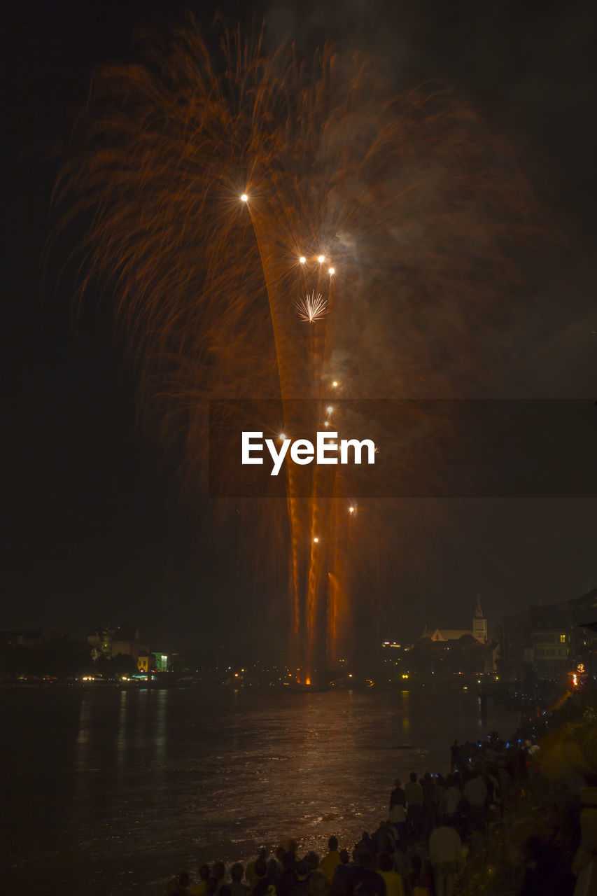 night, illuminated, firework display, firework - man made object, long exposure, blurred motion, exploding, celebration, outdoors, sky, river, motion, event, water, firework, arts culture and entertainment, large group of people, architecture, building exterior, city, nature