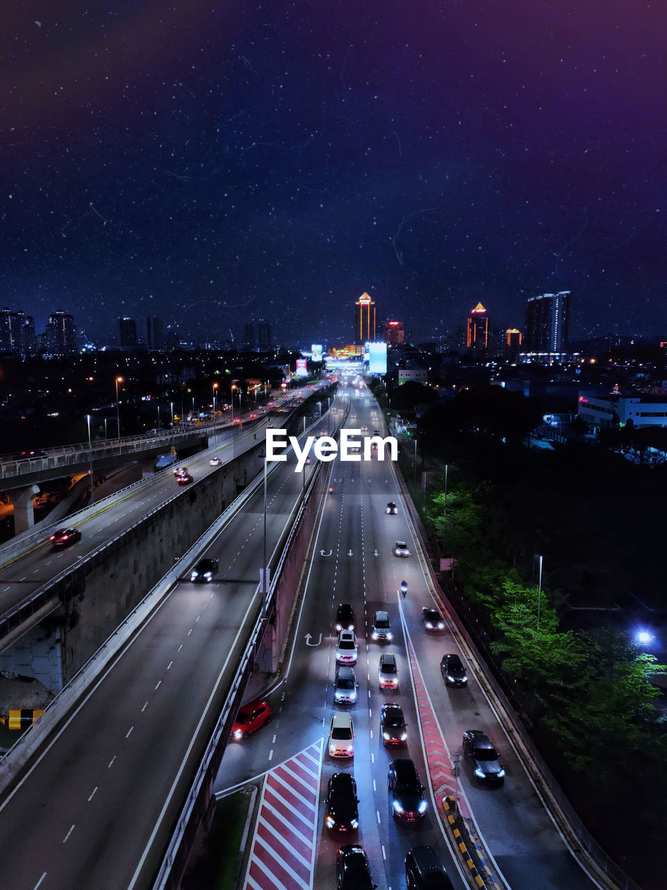 High angle view of highway in city at night