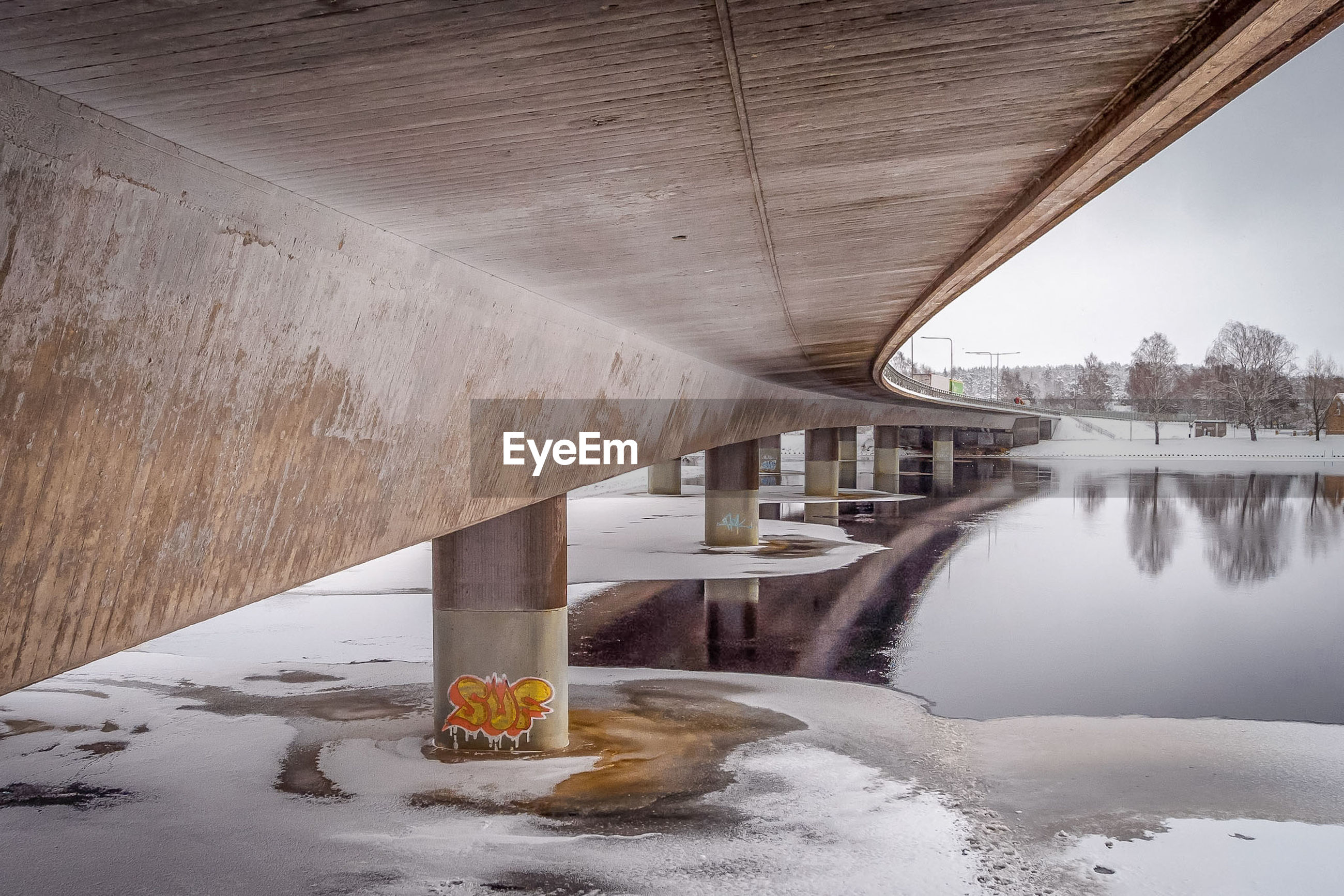 Low angle view of bridge over frozen river