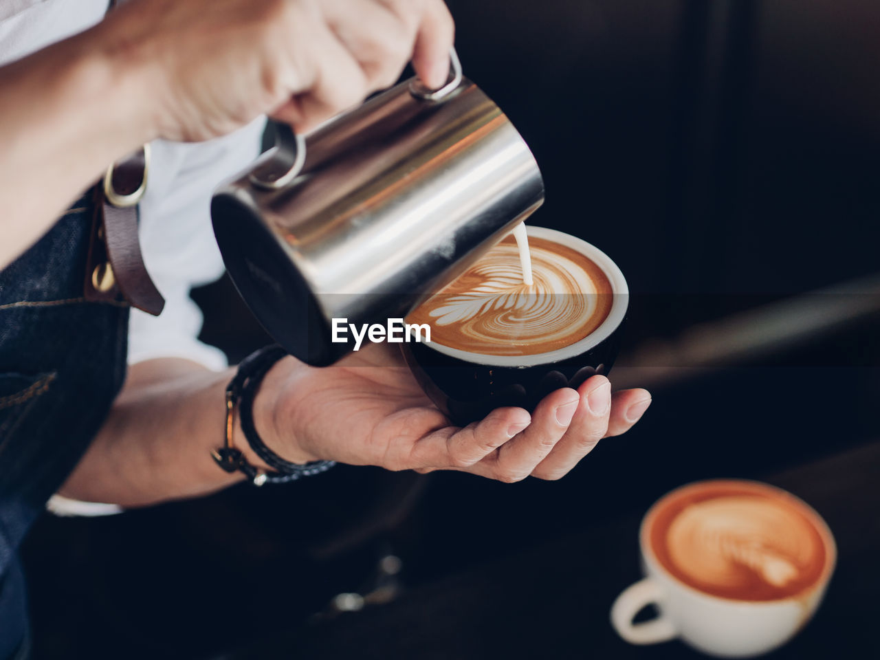 Cropped Image Of Person Preparing Coffee At Cafe