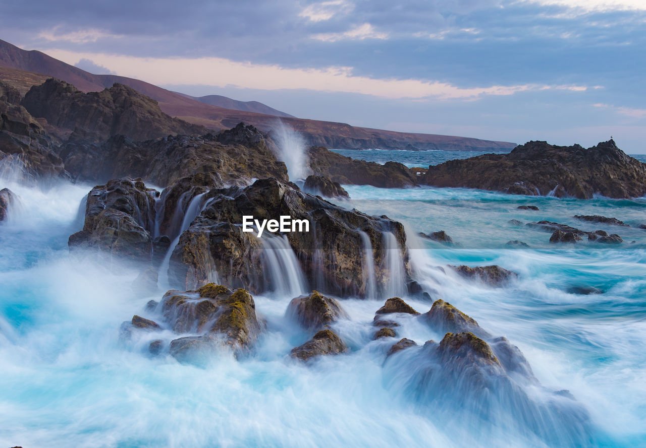 VIEW OF WATERFALL AT COAST