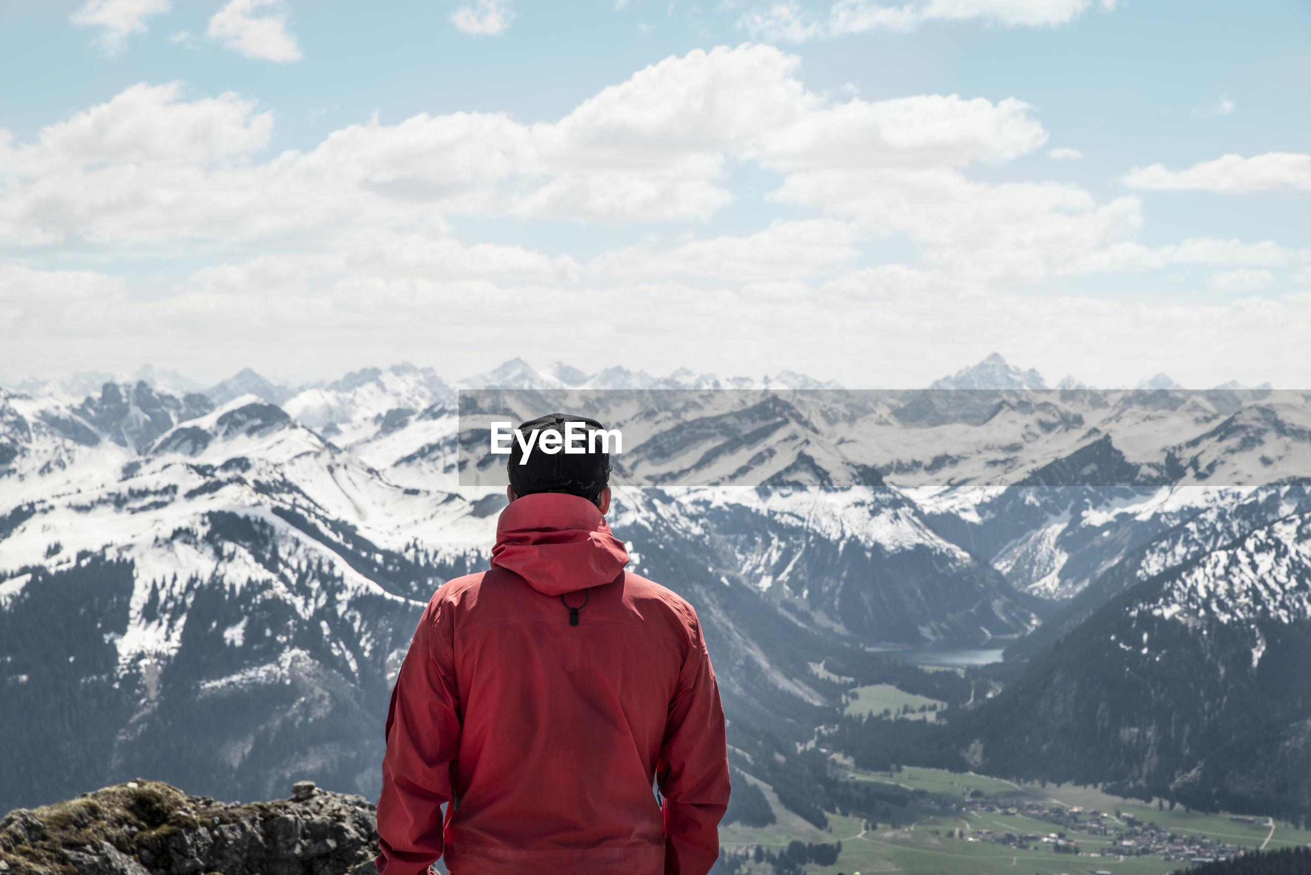 Rear view of man against european alps