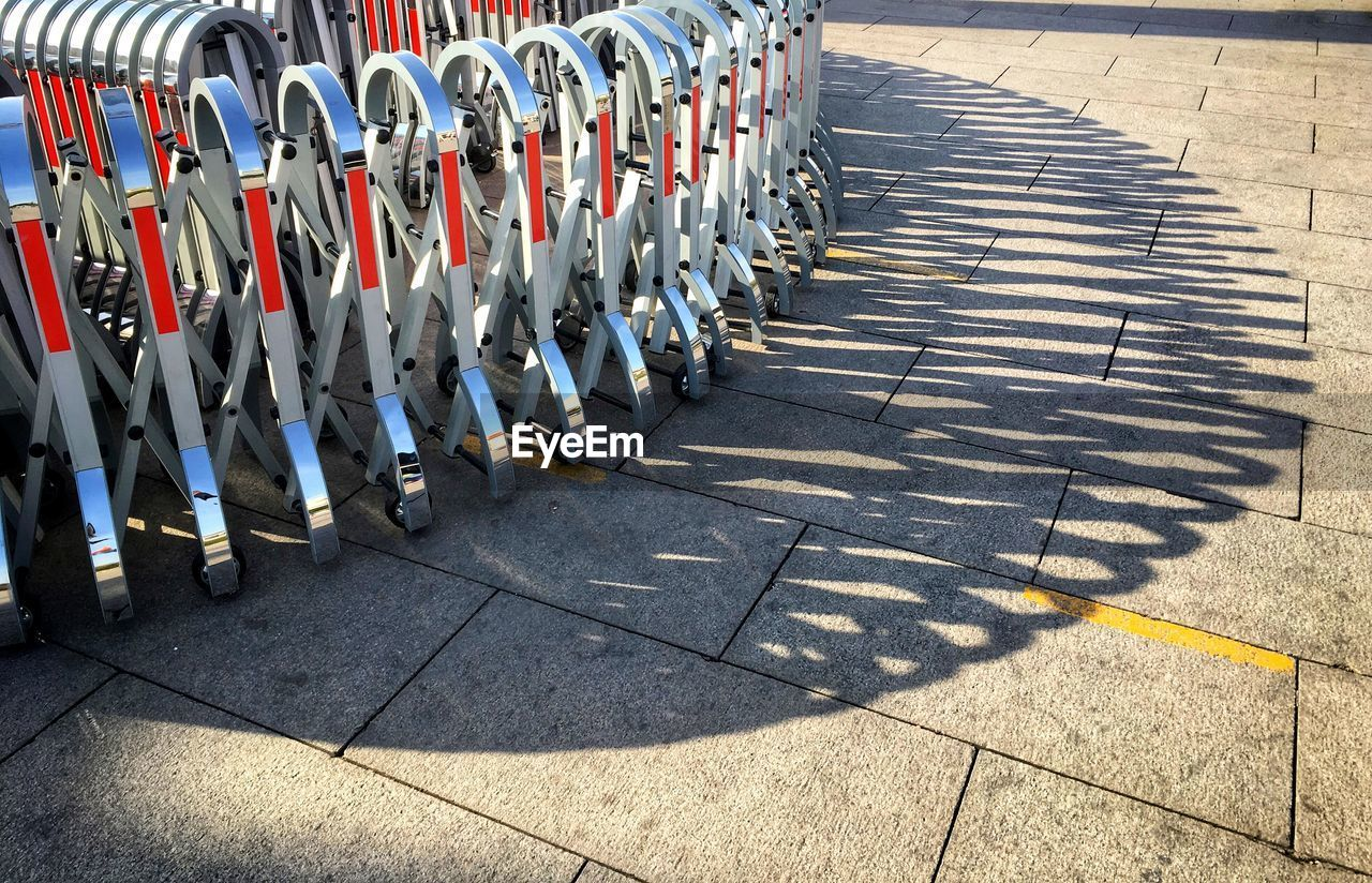 Metallic barriers on street during sunny day
