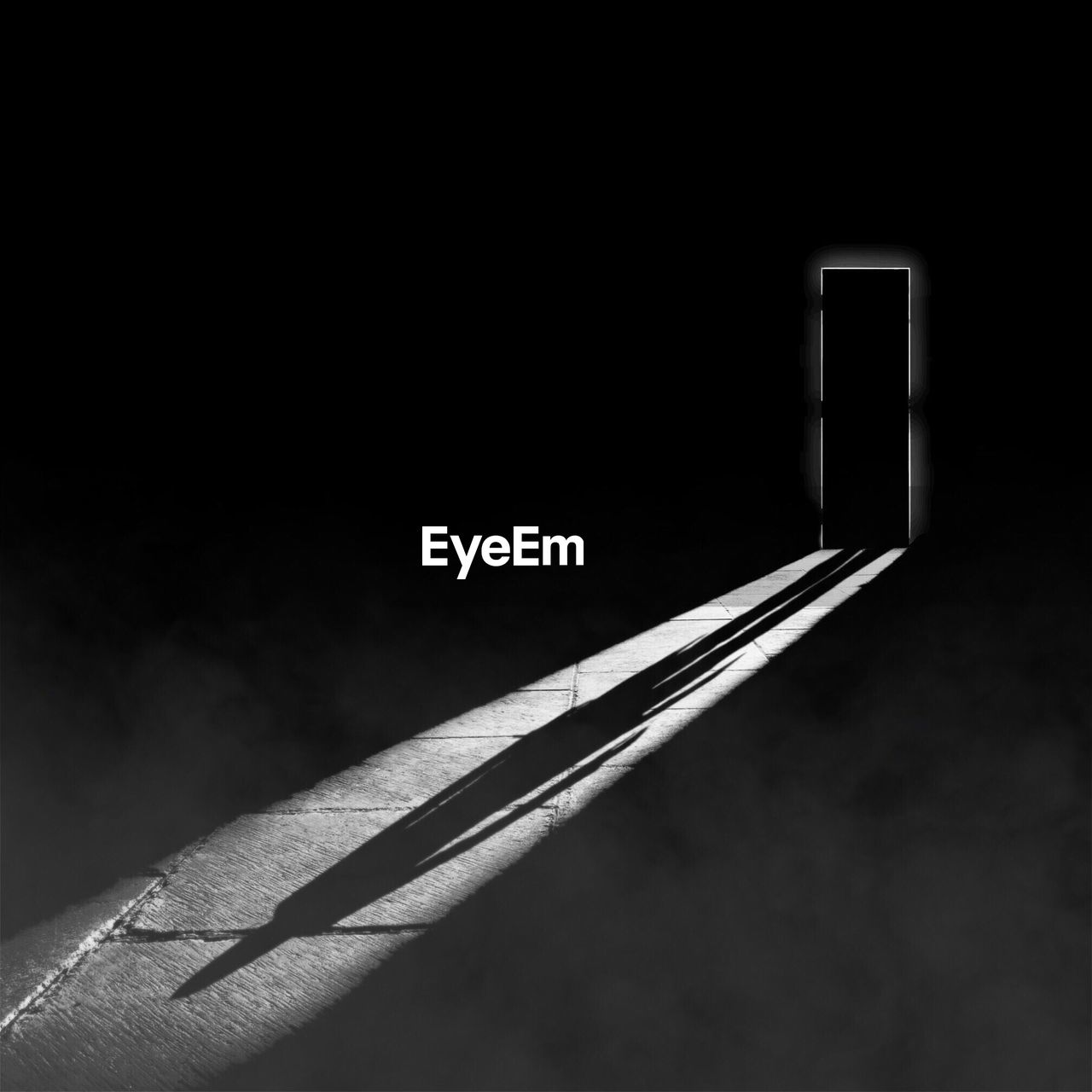 Shadow on empty flooring with closed door