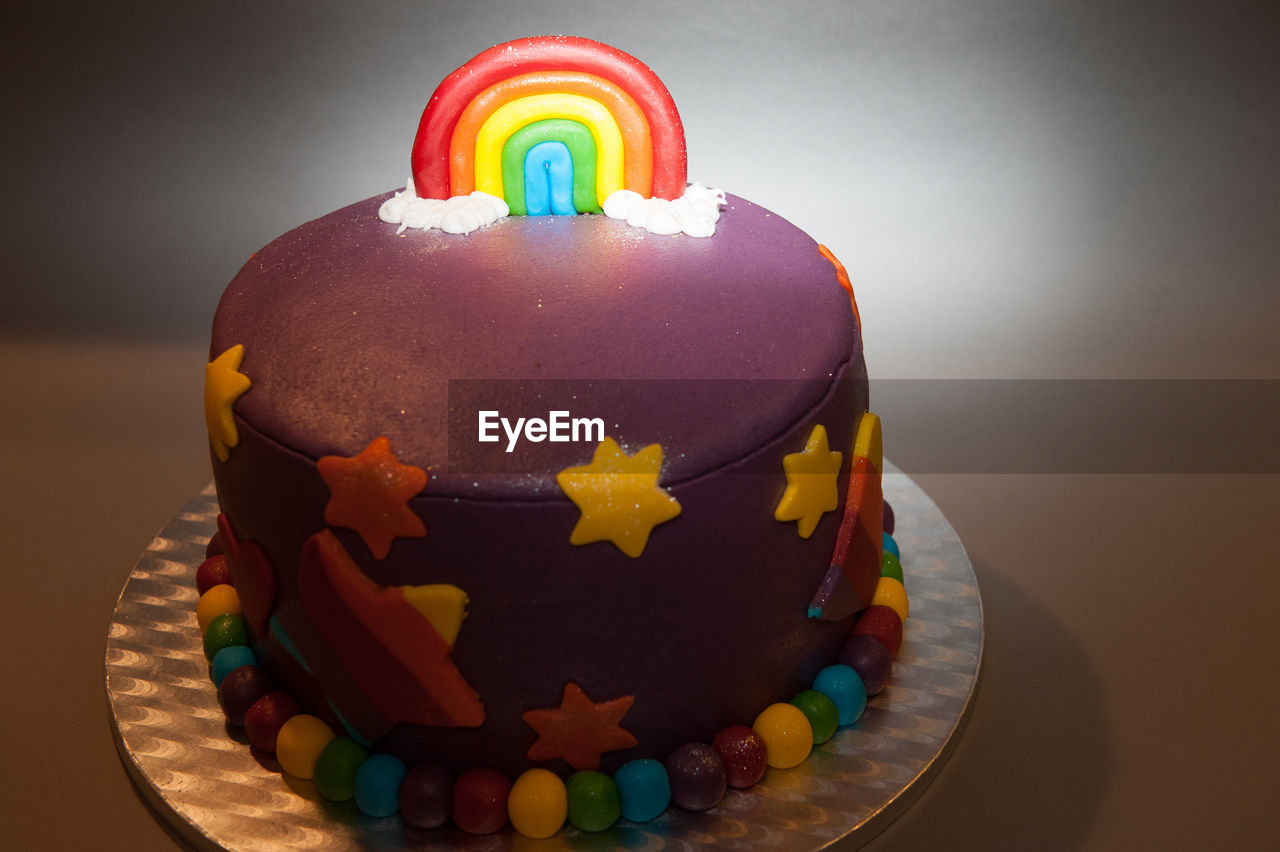 sweet food, food and drink, multi colored, dessert, temptation, indulgence, unhealthy eating, food, celebration, indoors, cake, table, freshness, no people, close-up, ready-to-eat, birthday cake, white background