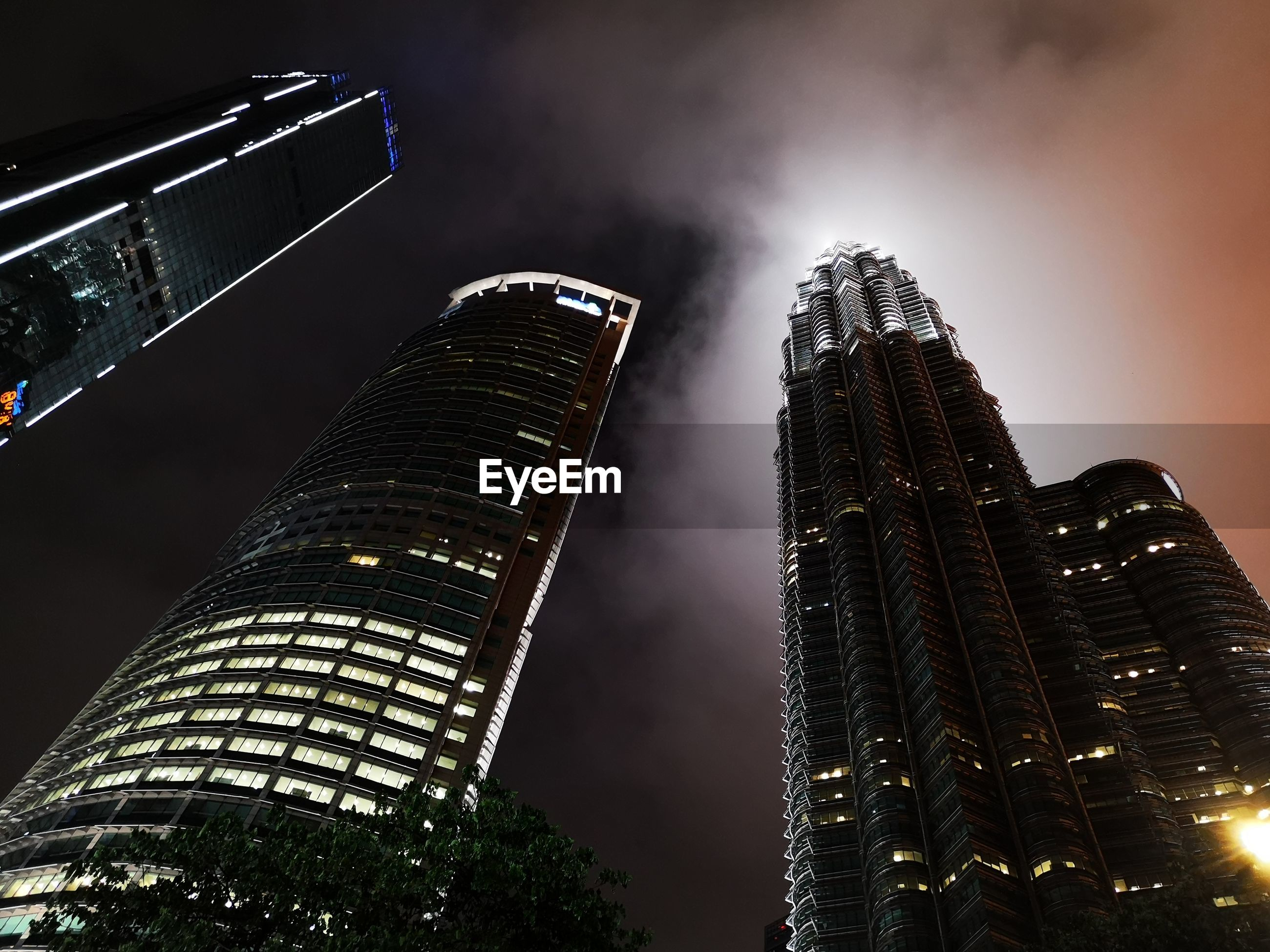 LOW ANGLE VIEW OF ILLUMINATED BUILDING AGAINST SKY