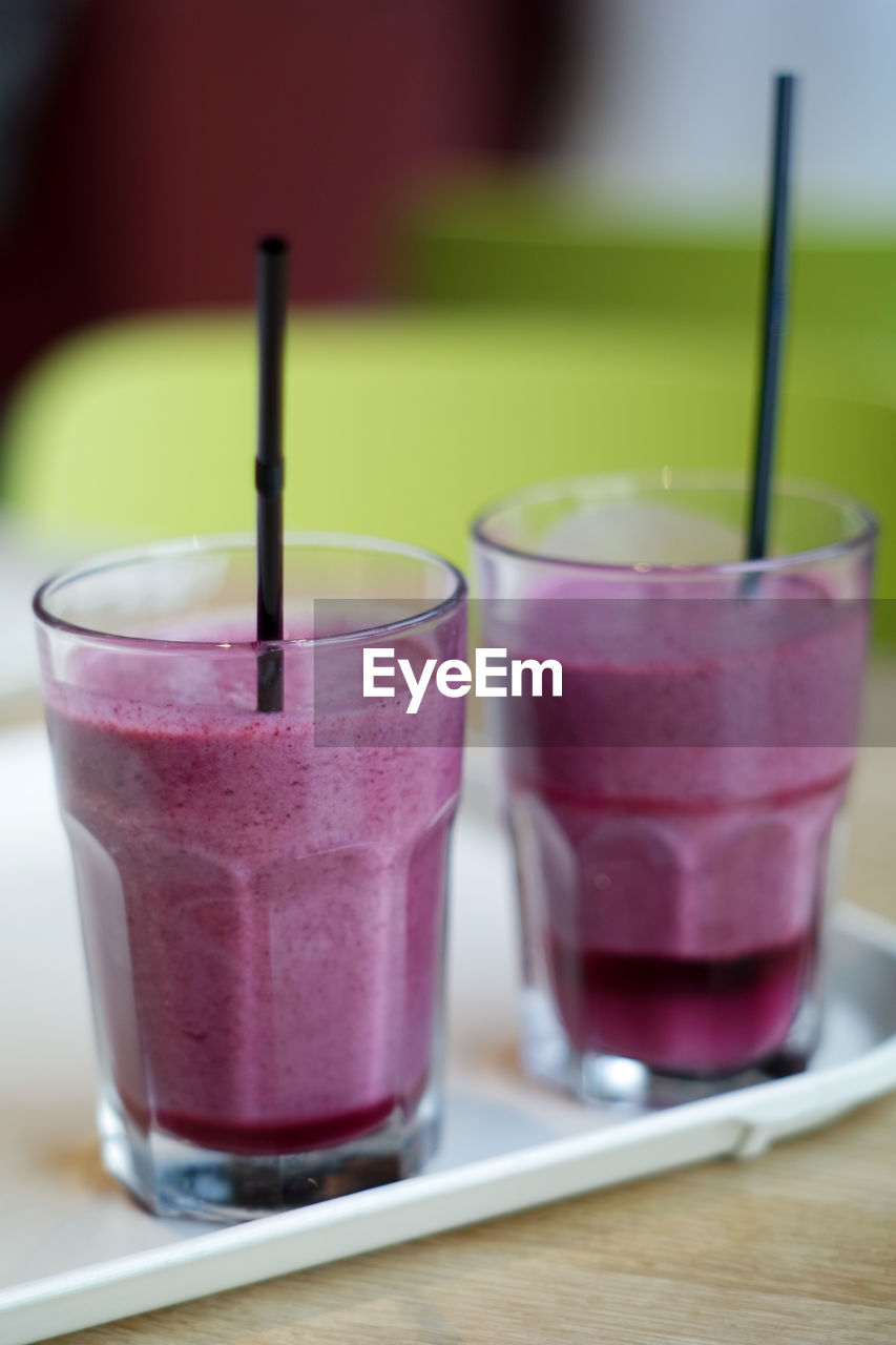 Close-up of smoothie in glasses on table