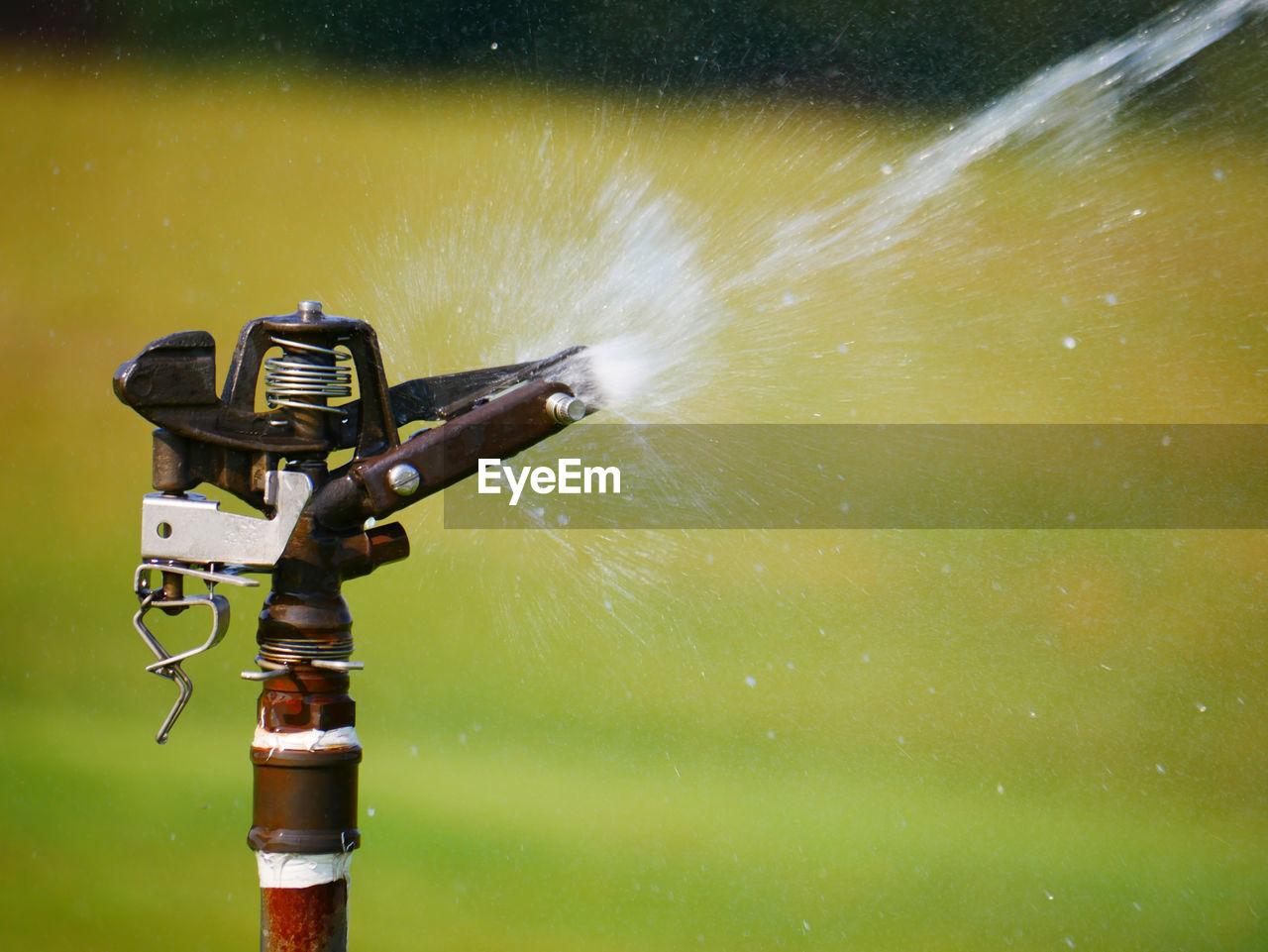 Close-up of water splashing from sprinkler