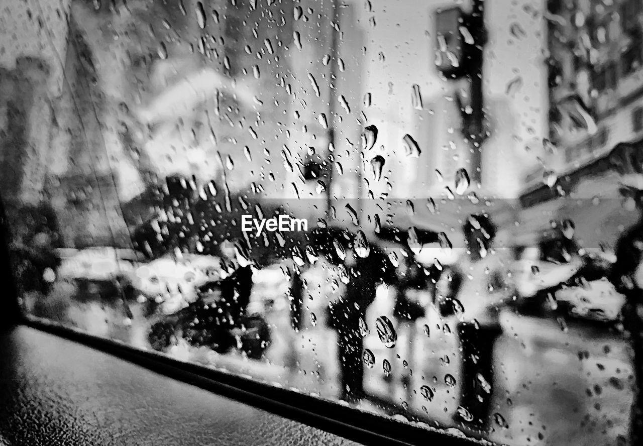 glass - material, transparent, window, drop, wet, rain, vehicle interior, water, mode of transportation, transportation, car, motor vehicle, land vehicle, raindrop, car interior, rainy season, indoors, no people, glass