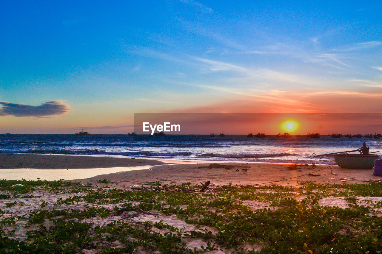 sea, beach, water, sunset, beauty in nature, scenics, shore, sky, nature, sand, tranquil scene, tranquility, horizon over water, outdoors, no people, nautical vessel, wave, day