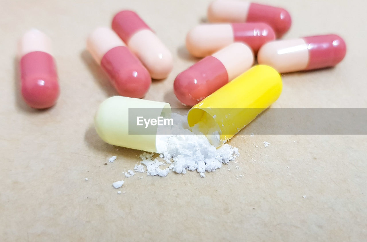 High angle view of pills against white background