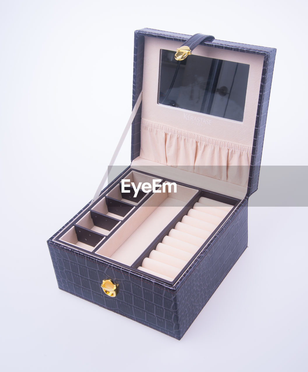 High angle view of empty jewelry box on gray background