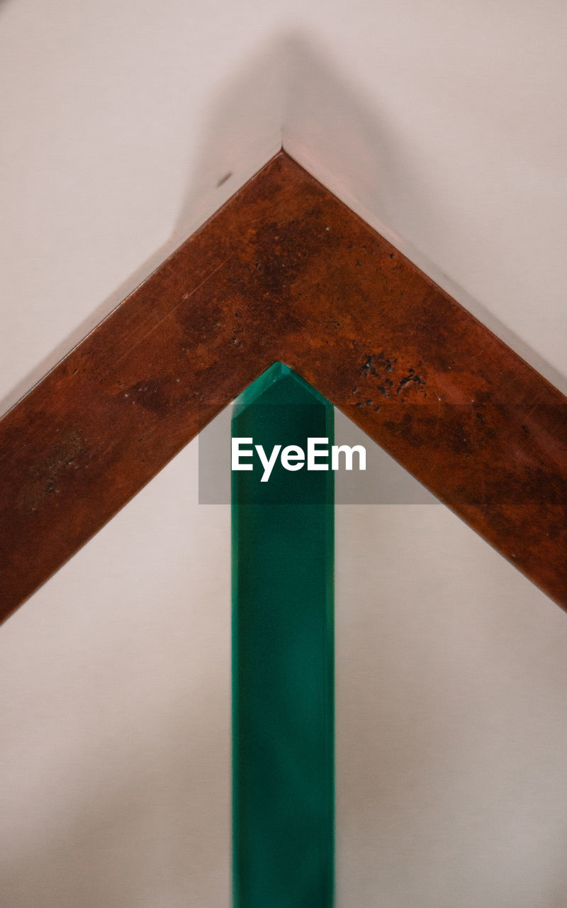 no people, low angle view, architecture, close-up, built structure, indoors, wood - material, green color, brown, pattern, day, studio shot, triangle shape, geometric shape, wall - building feature, shape, ceiling, building
