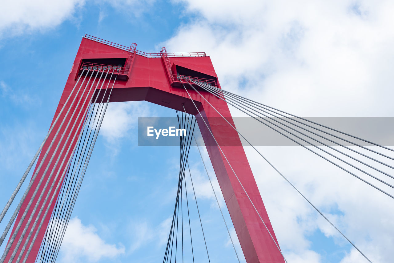 sky, cloud - sky, low angle view, red, built structure, architecture, suspension bridge, bridge - man made structure, nature, bridge, connection, day, no people, transportation, cable, cable-stayed bridge, tourism, outdoors, city