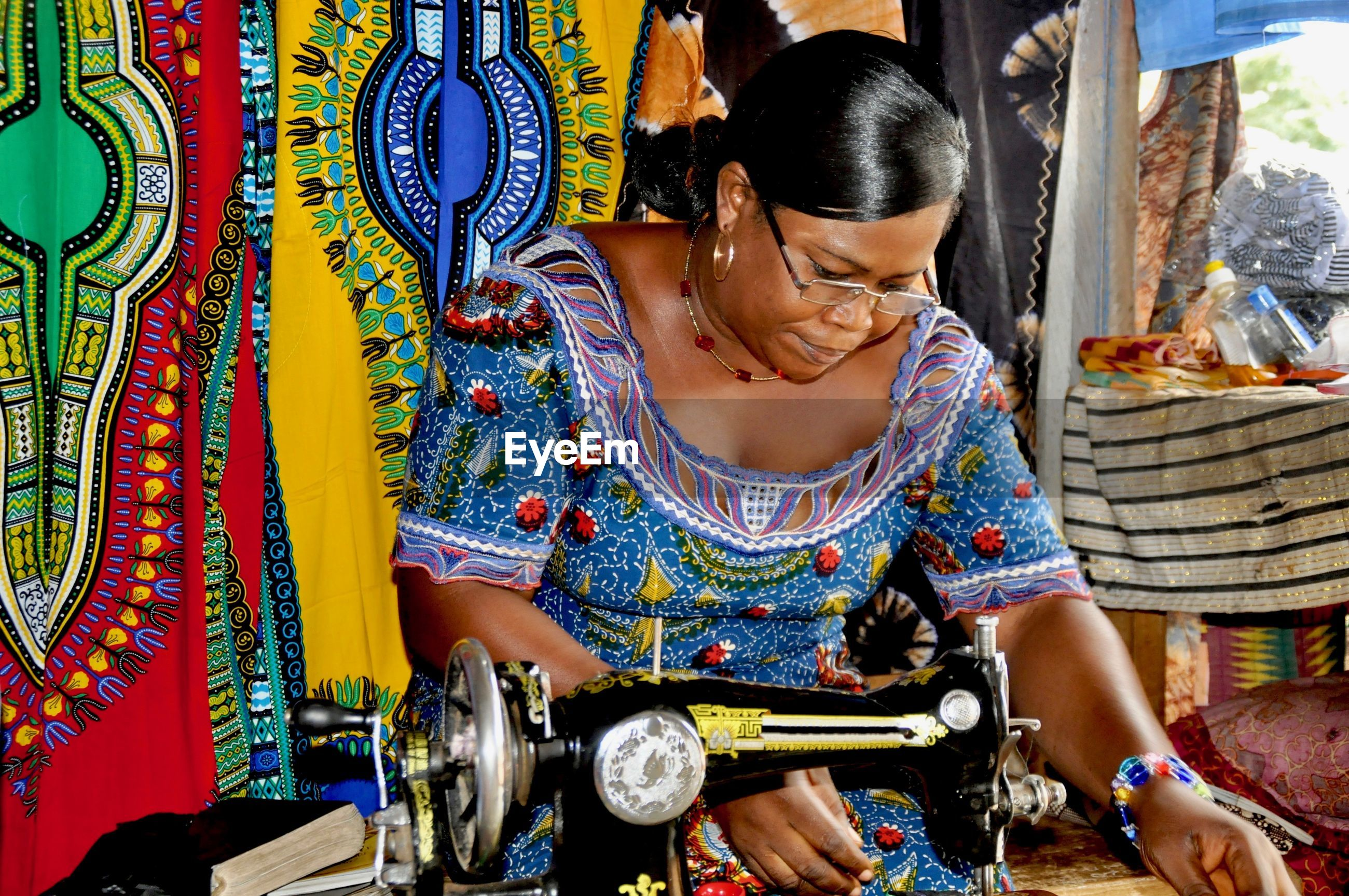Woman stitching in workshop