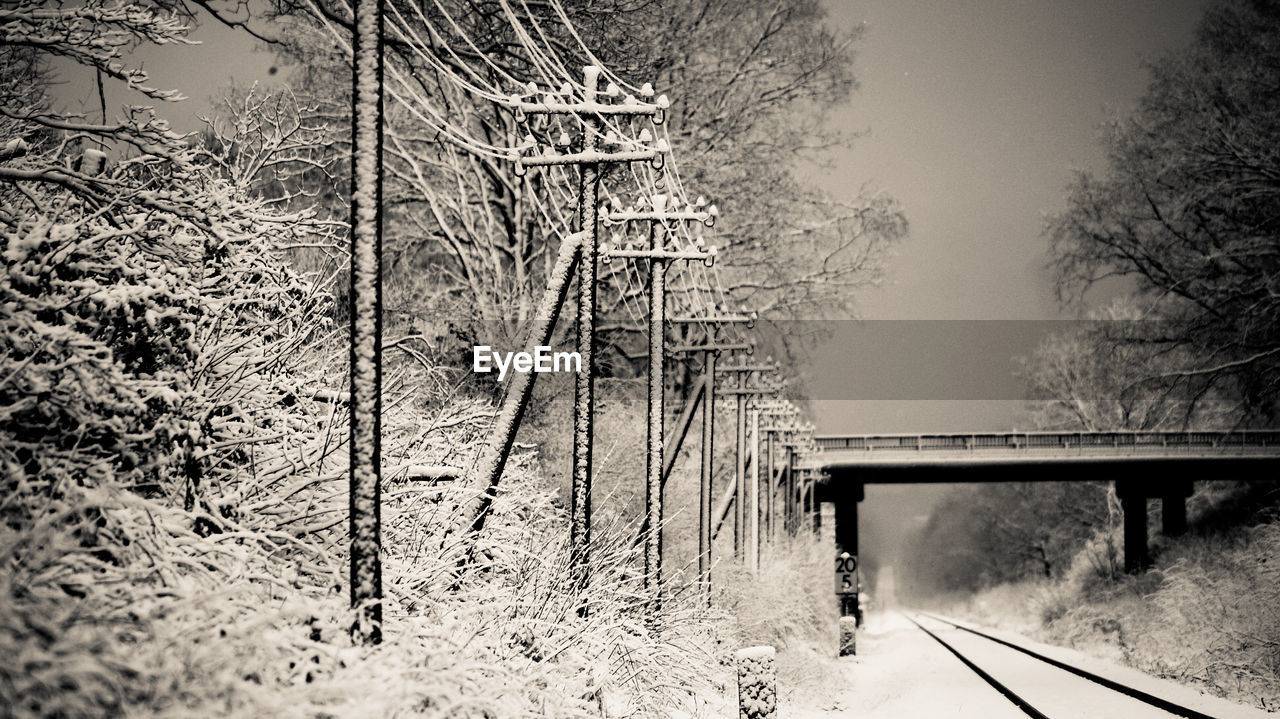 Railroad Track By Telephone Lines During Winter