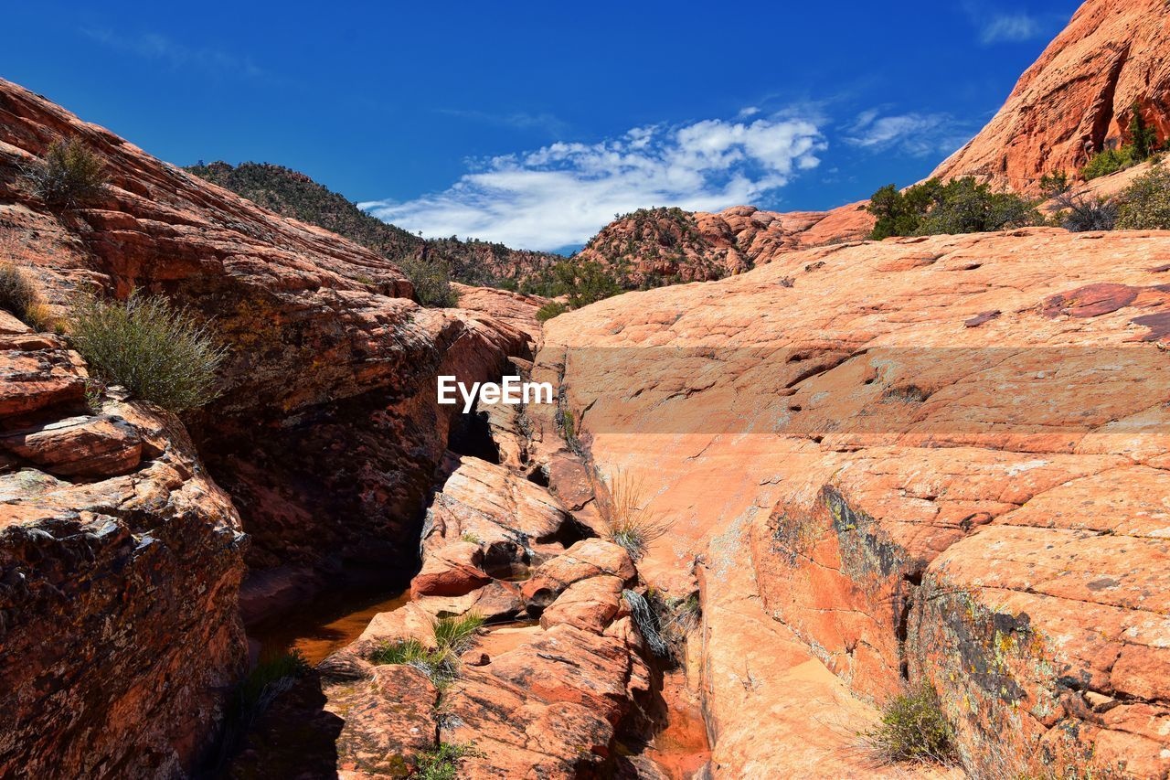 rock, sky, rock - object, rock formation, solid, beauty in nature, mountain, non-urban scene, scenics - nature, nature, tranquil scene, geology, tranquility, physical geography, no people, cloud - sky, day, remote, environment, mountain range, outdoors, formation, eroded, arid climate
