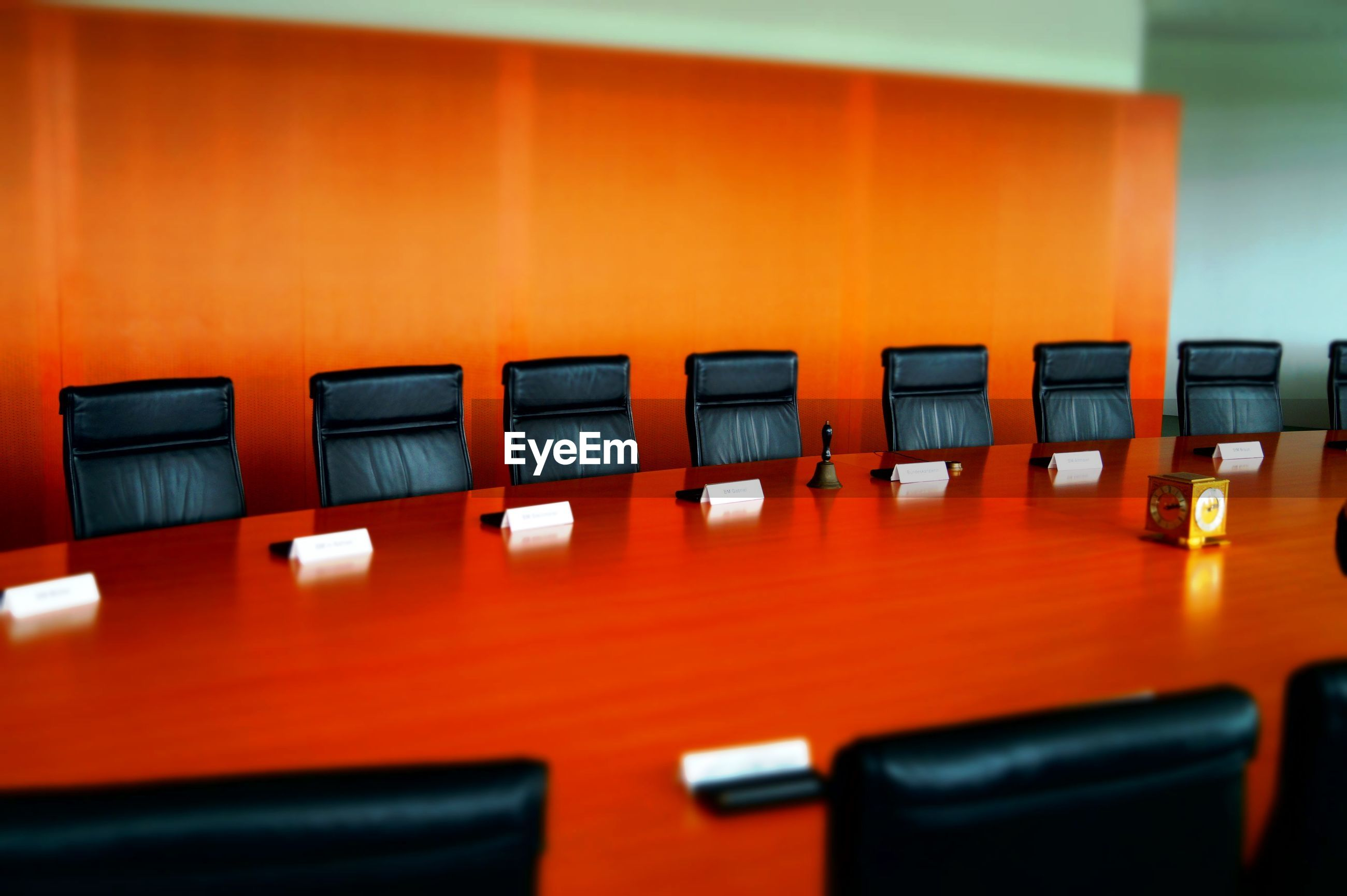 Empty chairs in board room at office