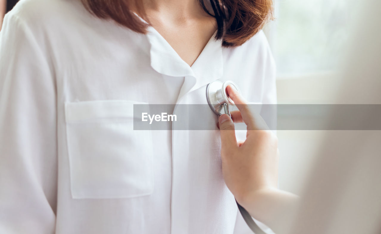 Cropped Hand Of Doctor Examining Patient With Stethoscope