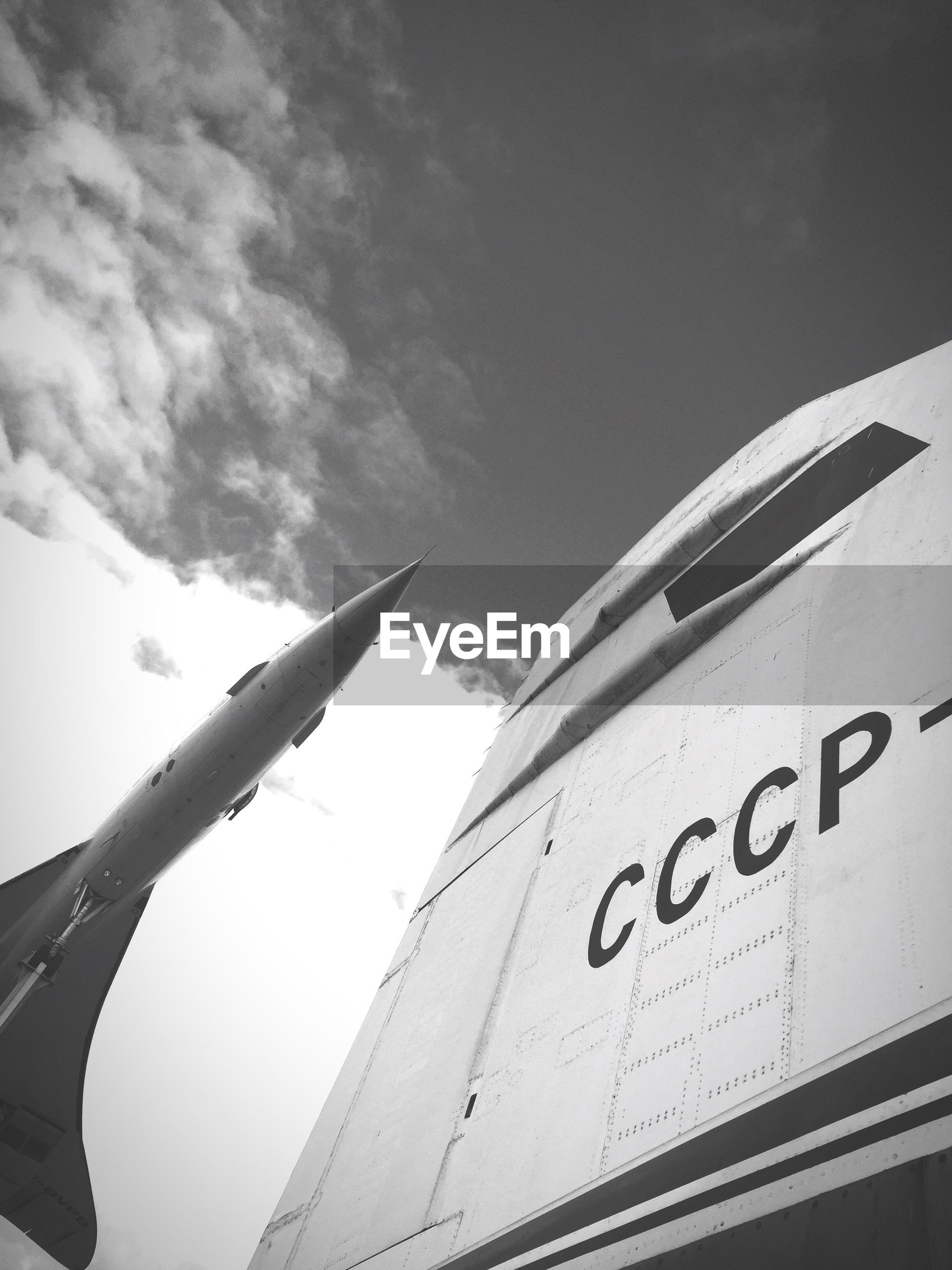 text, communication, day, low angle view, sky, transportation, no people, airplane, outdoors, close-up