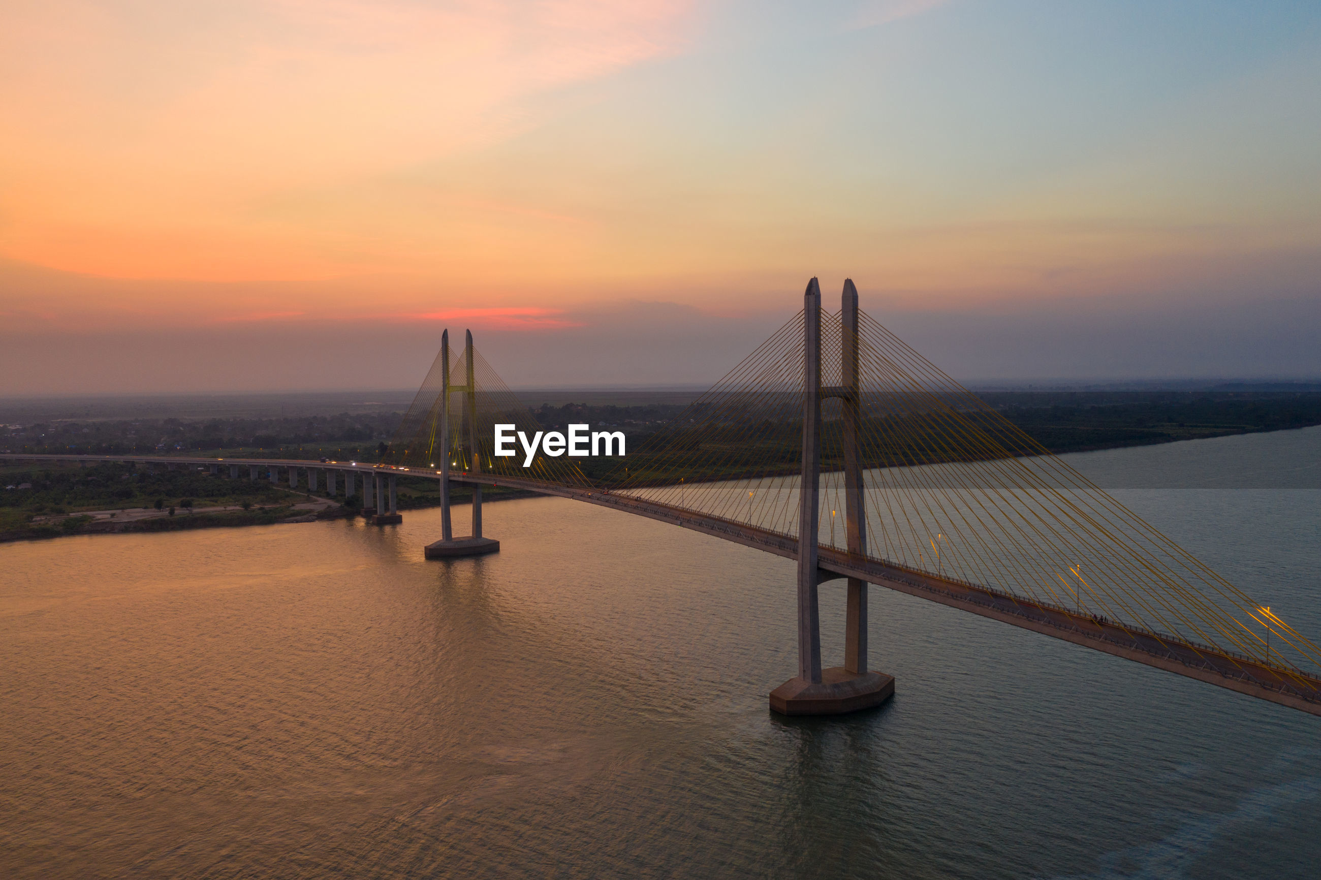 View of bridge over sea against sky during sunset