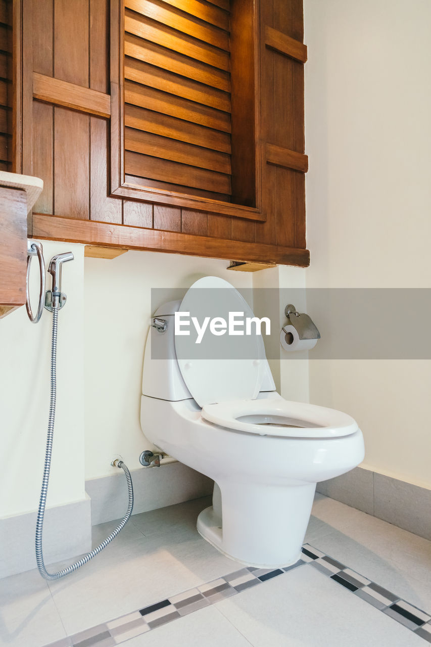 Toilet seat in bathroom