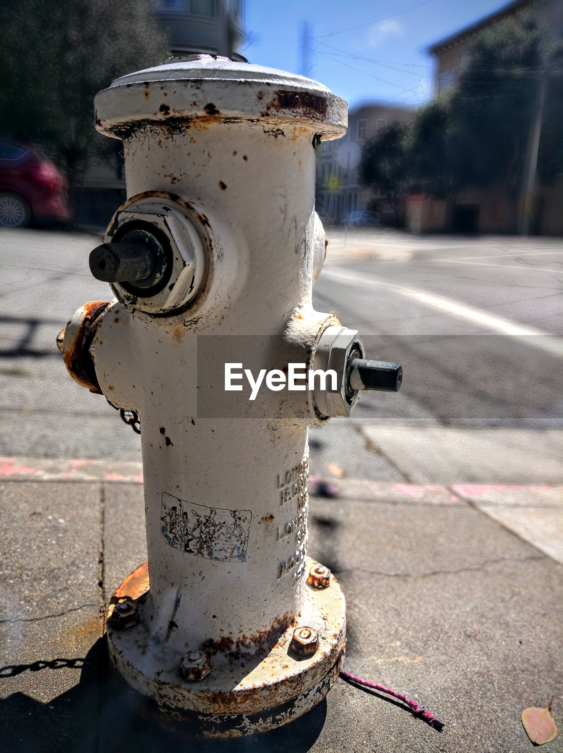 CLOSE-UP OF FIRE HYDRANT ON CITY STREET