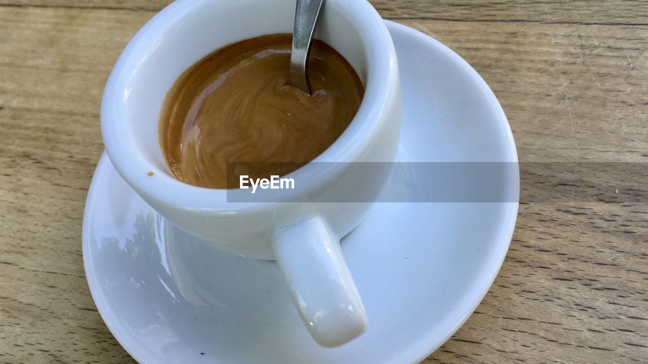 food and drink, table, drink, coffee, cup, coffee cup, still life, mug, refreshment, coffee - drink, crockery, saucer, indoors, freshness, close-up, high angle view, food, spoon, no people, frothy drink, non-alcoholic beverage, caffeine, tea cup