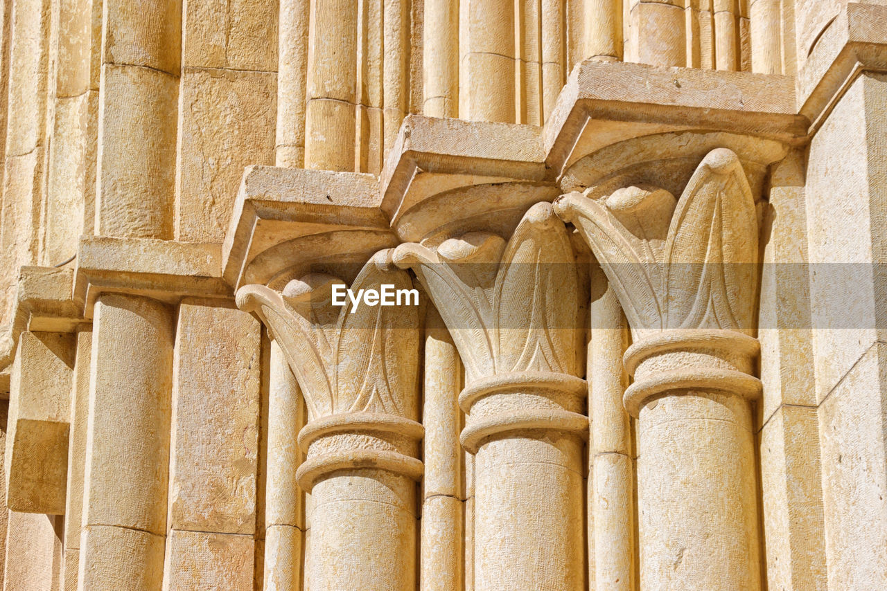 architecture, built structure, no people, the past, history, travel destinations, architectural column, building exterior, pattern, low angle view, ancient, architectural feature, day, building, craft, design, outdoors, old, carving - craft product, art and craft, ornate, ancient civilization, archaeology