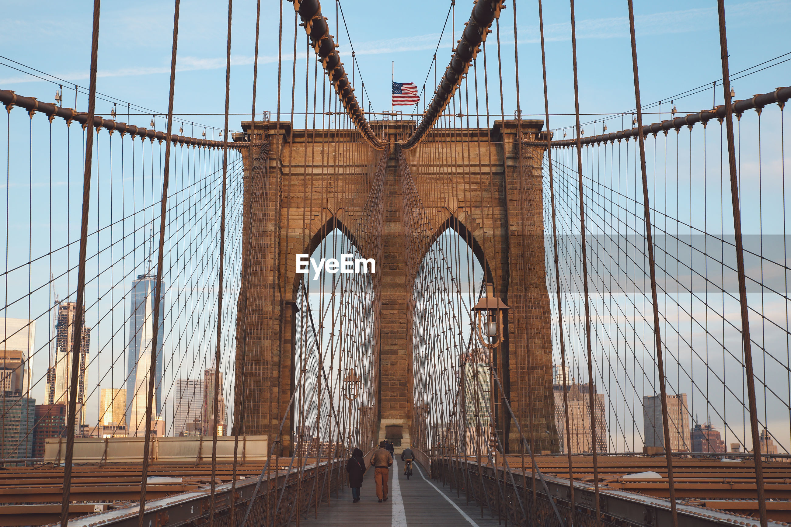 Low angle view of brooklyn bridge in city against sky
