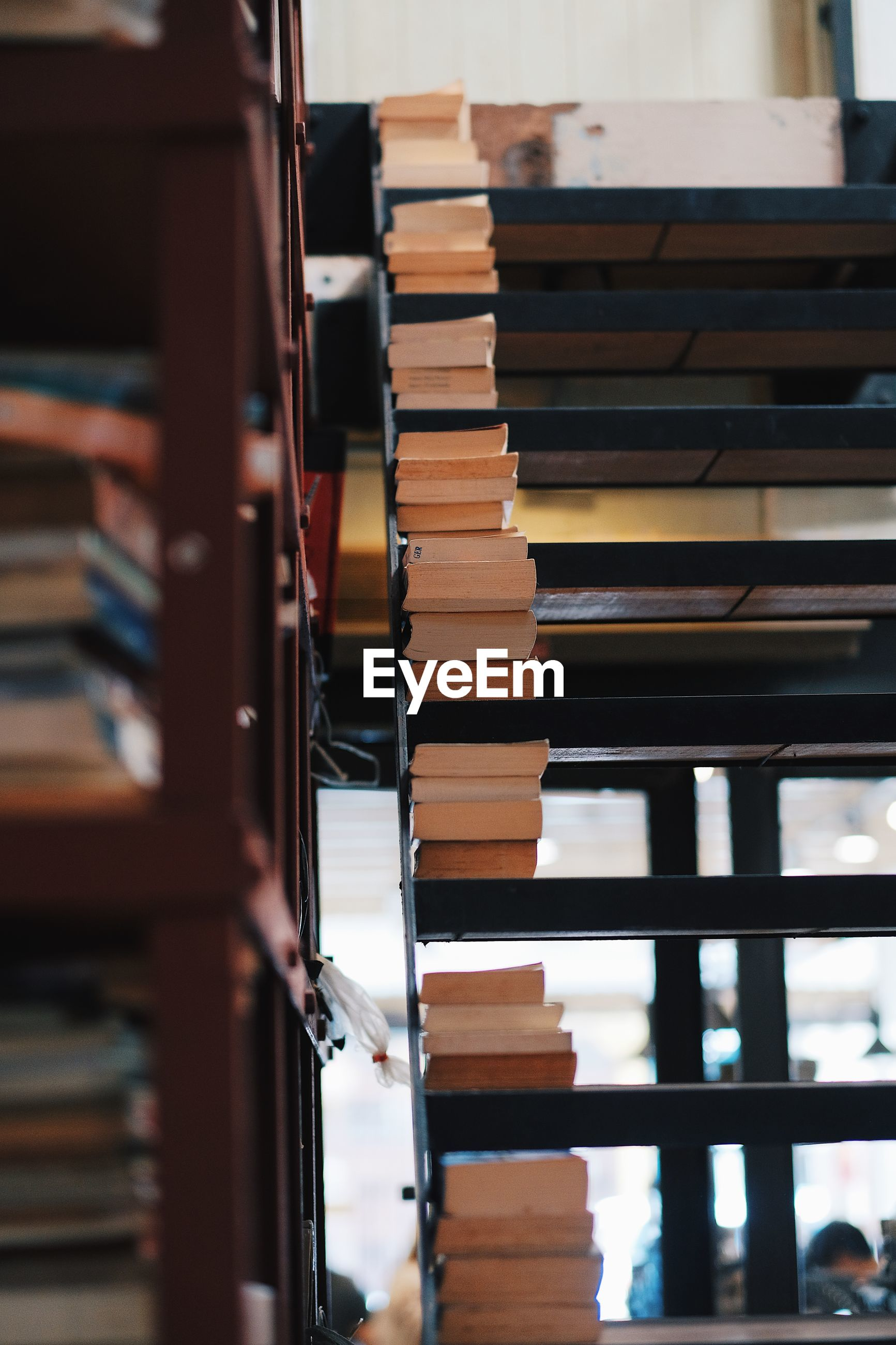 Stack of books on shelves in library