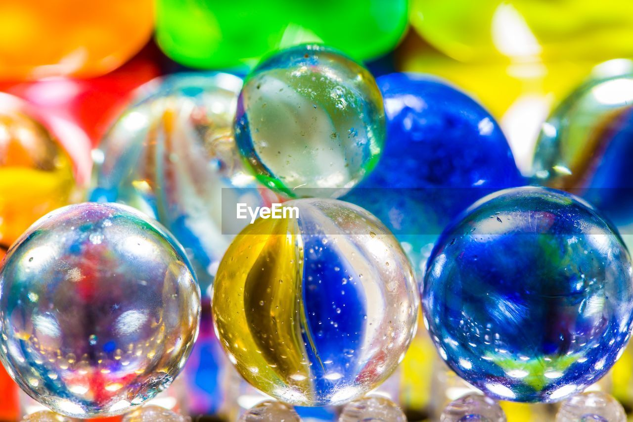 celebration, multi colored, still life, shiny, close-up, no people, celebration event, marbles, indoors, large group of objects, day