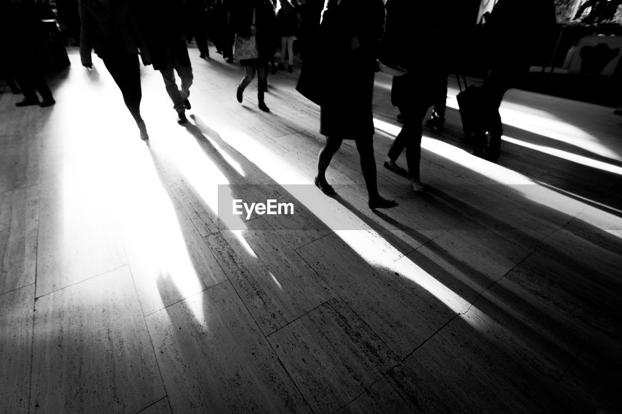 walking, low section, real people, human leg, women, lifestyles, large group of people, men, day, indoors, human body part, adult, people